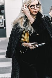 coat,gold bag,tumblr,fashion week 2017,streetstyle,black coat,bag,metallic,watch,silver watch,hoodie,black hoodie,pants,black pants,velvet,velvet pants,glasses,miu miu,jewels,jewelry,ring,necklace,black velvet pants