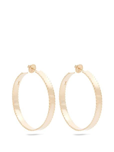 Alison Lou earrings gold yellow jewels