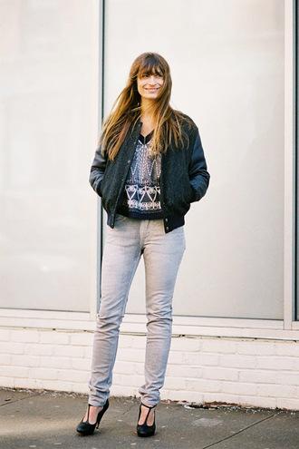 vanessa jackman blogger t-strap heels grey jeans baseball jacket jeans