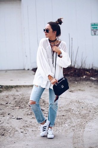 fashionably kay blogger jewels sunglasses jewelry black bag ripped jeans long sleeves white sneakers adidas see through round sunglasses