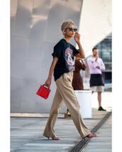 bag,mini bag,handbag,red bag,wide-leg pants,black t-shirt,sunglasses,necklace,mid heel sandals