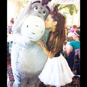 shirt,ariana grande,black shirt,frilly white skirt,mickey mouse headband,eeyore,skirt