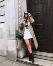 coat,long coat,ankle boots,black boots,white skirt,black bag,black top,black sunglasses