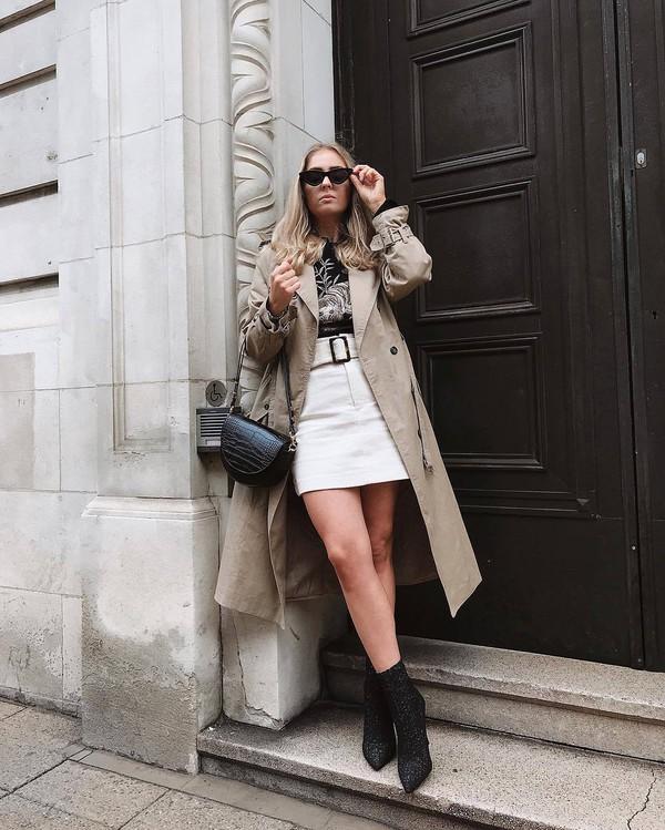 coat long coat ankle boots black boots white skirt black bag black top black sunglasses