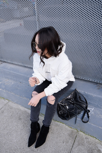 the fancy pants report blogger sweater jeans shoes hoodie grey jeans black bag ankle boots winter outfits ripped jeans skinny jeans white hoodie pointed boots top tumblr denim boots black boots bag sunglasses