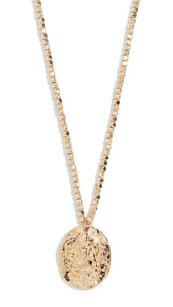 Shashi Nugget Coin Necklace in gold / yellow
