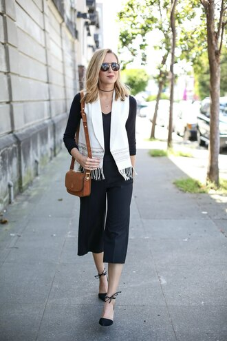 the classy cubicle blogger bag jewels sleeveless white jacket cropped pants black pants shoulder bag choker necklace round sunglasses lace up flats black flats black top long sleeves