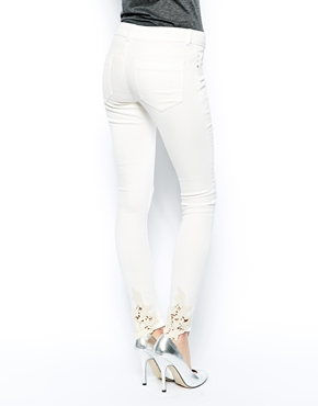 ASOS | ASOS Whitby Low Rise Skinny Jeans in Cream with Crochet Hem at ASOS