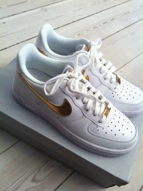 gold nike shoes with white tick