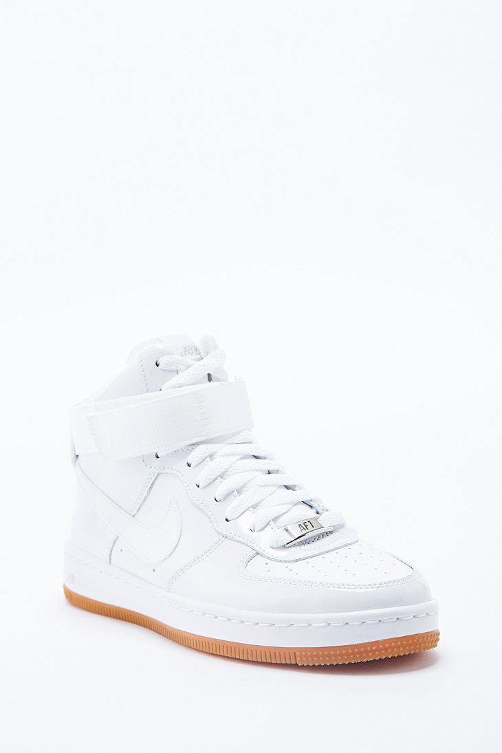 Nike air force 1 mid top leather trainers in white