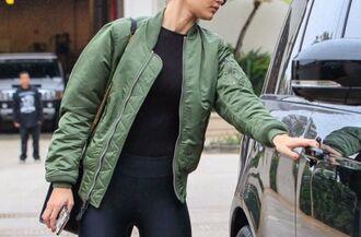 jacket coat khaki leggings gigi hadid leggings gigi hadid bomber jacket black leggings green bomber jacket gigi hadid gigi hadid style celebrity celebrity style sneakers black sneakers sunglasses black top