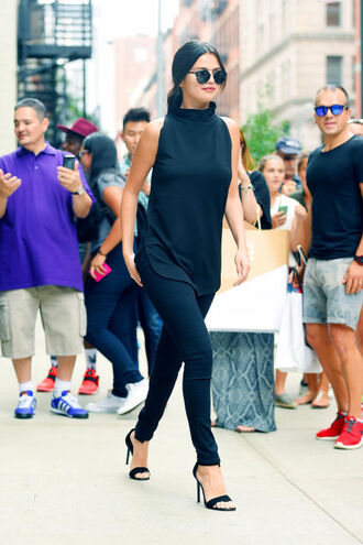 heels tank top black selena gomez celebrity celebrity style black jeans black heels high neck black top all black everything pants black pants high heel sandals sandals black sandals sunglasses black sunglasses sandal heels blouse