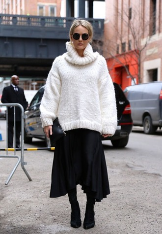 sweater white oversized sweater black pleated skirt black heeled boots blogger round sunglasses