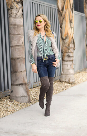 thehuntercollector blogger blouse jeans jacket shoes bag sunglasses belt vest thigh high boots over the knee boots winter outfits