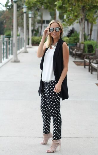 pants polka dot pants polka dots top white top sunglasses mirrored sunglasses sandals sandal heels high heel sandals nude sandals vest black vest spring outfits streetstyle shoes