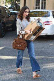 jeans,flare jeans,lily collins,sweater,slide shoes,streetstyle