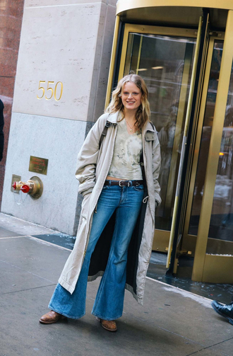 jeans nyfw 2017 fashion week 2017 fashion week streetstyle 00s style blue jeans denim flare jeans top crop tops coat grey coat grey long coat long coat shoes brown shoes