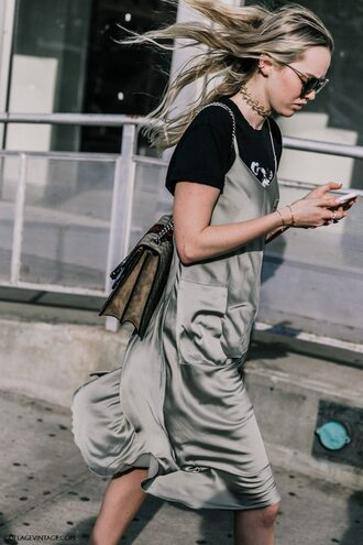 dress fashion week street style fashion week 2016 fashion week slip dress silver dress dress over t-shirt t-shirt streetstyle black t-shirt bag tumblr satin dress satin silk slip dress