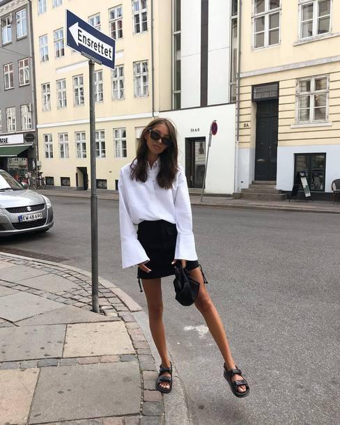 skirt black skirt mini dress sandals bag white shirt long sleeves sunglasses