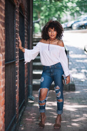 heygorjess,blogger,top,jeans,bag,jewels,shoes,white off shoulder top,long sleeves,off the shoulder,off the shoulder top,white top,curly hair,ripped jeans,blue jeans,ripped skinny jeans,fringe shoes,brown sandals,sandals,sandal heels,high heel sandals,clutch,printed clutch