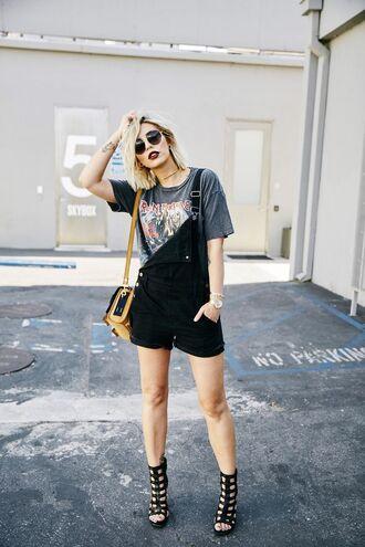 pants grey graphic t-shirt black cutout heels yellow bag blogger sunglasses black overalls