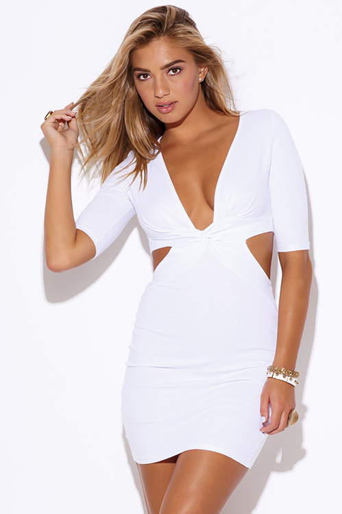 White deep cut mini dress.