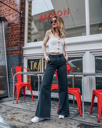 top black jeans sneakers sunglasses button up white top jeans wide-leg pants