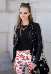 pants,print,cara delevingne,jeans,orange,white jeans,fish,clothes,jacket,jewels