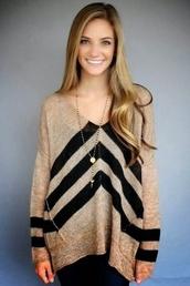 black stripes,black triangles,pockets,top,geometric shapes