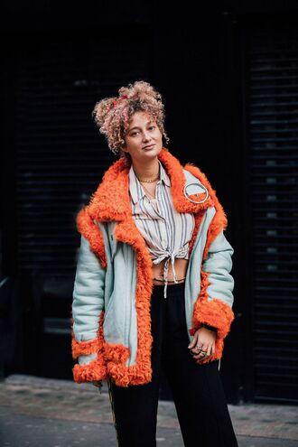 jacket london fashion week 2017 fashion week 2017 fashion week streetstyle blue jacket orange shearling jacket shirt stripes striped shirt crop tops pants black pants wide-leg pants hairstyles