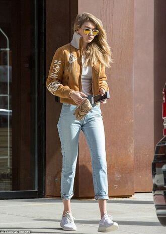 jeans gigi hadid denim high waisted jeans boyfriend jeans skinny jeans blue jeans jacket streetstyle fashion week 2016 shoes sneakers ny fashion week 2016 gigi hadid bomber jacket