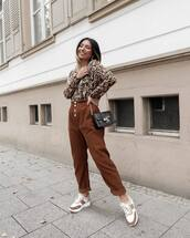 pants,high waisted pants,baggy pants,sneakers,zara,blouse,leopard print,shoulder bag,mini bag