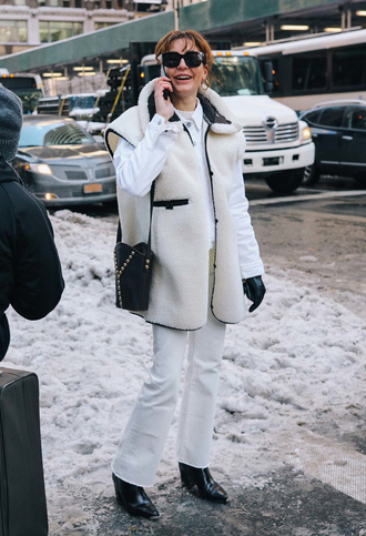 shirt white vest nyfw 2017 fashion week 2017 fashion week streetstyle vest shearling vest white shirt denim jeans white jeans flare jeans boots black boots bag black bag leather gloves gloves sunglasses all white everything