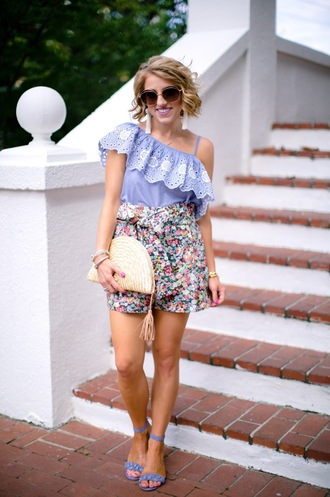 something delightful blogger top shorts sunglasses bag shoes jewels clutch ruffled top ruffle sandals flowered shorts summer outfits blue heels