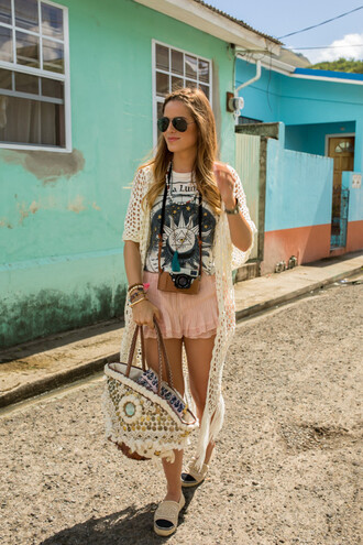 gal meets glam blogger pastel pink summer outfits flats bag shoes jewels raffia bag beach bag graphic tee moon and sun boho chic pink shorts