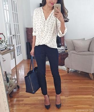 shirt business casual polka dots casual friday top wrap top white top pants black pants pointed toe pumps pumps black pumps bag black bag