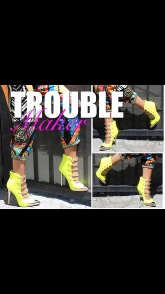 neon yellow booties with gold chains metallic cap
