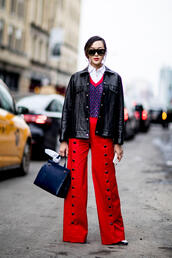 pants,nyfw 2017,fashion week 2017,fashion week,streetstyle,red pants,wide-leg pants,sweater,blue sweater,shirt,white shirt,jacket,black jacket,black leather jacket,leather jacket,bag,blue bag,sunglasses