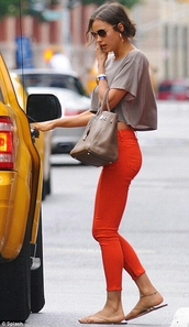 jeans,shirt,top,orange,colorful,bright,denim,pockets,skinny jeans,mid rise jeans,low rise,summer,summer outfits,casual,dressy,chic,smart,orange jeans,irina shayk,model,model off-duty,victoria's secret,victoria's secret model,city outfits,lazy day outfit,red jeans,crop tops,grey crop top,bag,hermes,grey bag,sunglasses
