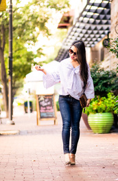 cute & little,blogger,belt,shoes,bag,work outfits,striped shirt,stripes,bow,bell sleeves,denim,jeans,skinny jeans,sunglasses