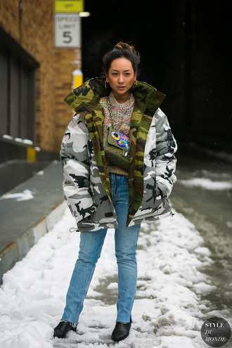 jacket tumblr nyfw 2017 fashion week 2017 fashion week streetstyle camouflage camo jacket puffer jacket sweater printed sweater bag green bag denim jeans blue jeans boots black boots oversized oversized jacket winter outfits winter jacket winter look