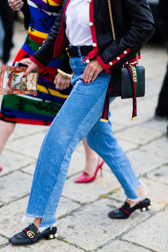 jeans fashion week street style fashion week fashion week 2016 milan fashion week 2016 blue jeans patchwork shoes gucci gucci shoes bag black bag gucci bag streetstyle belt pilgrim shoes high heel loafers