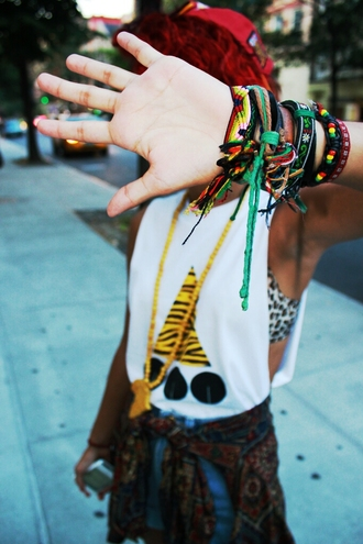shirt leopard print triangle animal print colorful patterns yellow red hat jacket circles bralette jeans bracelets reggae african print