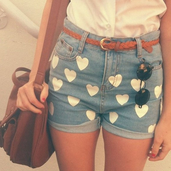 white shirt shorts belt white hearts sunglasses folded