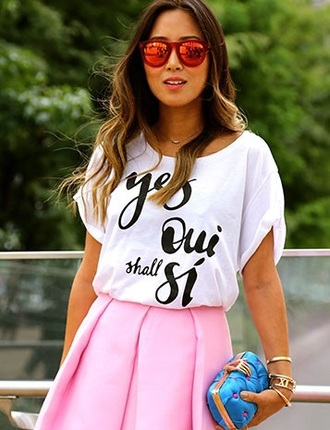 blogger streetstyle white t-shirt red sunglasses mirrored sunglasses pink skirt midi skirt song of style quote on it bag blue clutch metallic instagram