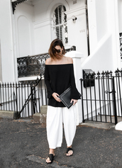 modern legacy,blogger,off the shoulder top,white pants,wide-leg pants,leather clutch,minimalist,black and white,black off shoulder top,long sleeves,bell sleeves,bell sleeve top,off the shoulder,clutch,black clutch,sunglasses,culottes,slide shoes,black slides