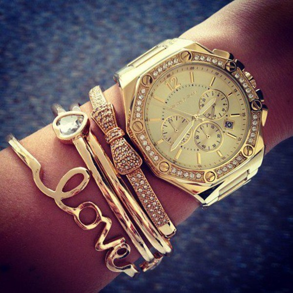 jewels bracelets watch gold bracelets chic michael kors gold ring gold accessories love bracelets rose gold trendy clothes jewelry bows glitter diamonds heart love culture michael kors watch michael kors ring girly