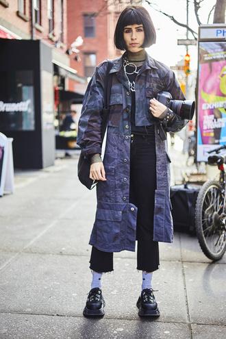 coat nyfw 2017 fashion week 2017 fashion week streetstyle androgynous non-binary denim jeans black jeans cropped jeans t-shirt black t-shirt camouflage socks shoes black shoes bag black bag