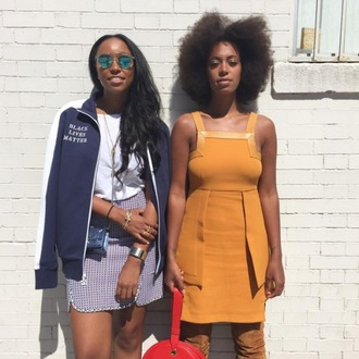 jacket black lives matter blue jacket t-shirt white t-shirt dress orange dress orange mini dress curly hair solange knowles celebrity style celebrity mini skirt printed skirt bracelets jewels jewelry black girls killin it glasses