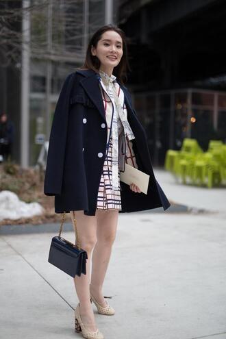 skirt nyfw 2017 fashion week 2017 fashion week streetstyle mini skirt printed skirt shirt blazer printed blazer coat black coat bag black bag chain bag heels pumps thick heel nude heels spring outfits
